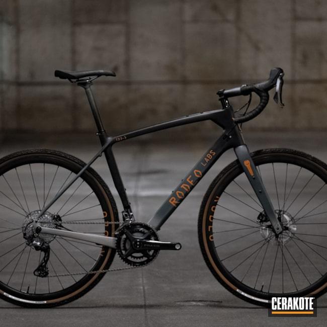 Custom Carbon Fiber Rodeo Labs Bike Cerakoted Using Charcoal Green, Tequila Sunrise And Titanium