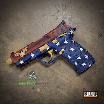 Battleworn Wonder Women Themed Smith & Wesson Shield Cerakoted Using Nra Blue And Firehouse Red