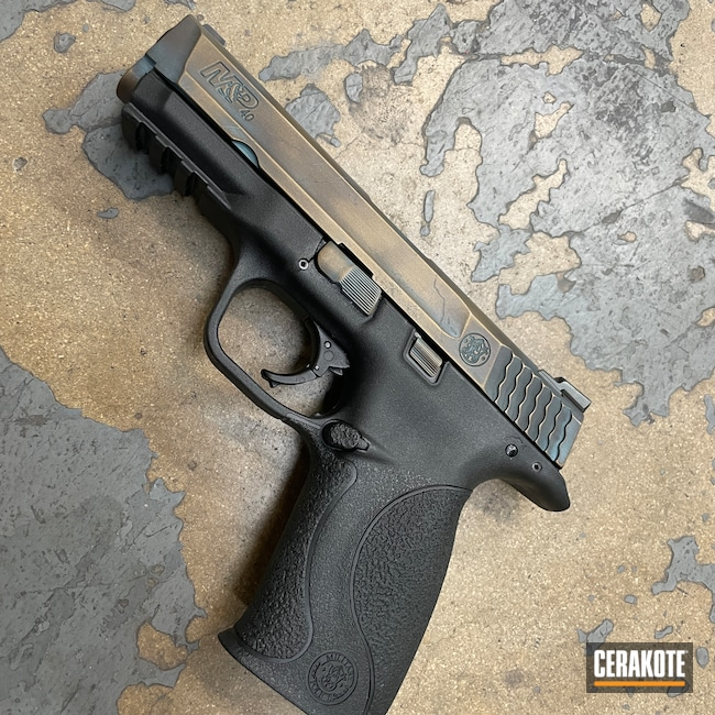 Cerakoted: S.H.O.T,Distressed,Smith & Wesson M&P,Armor Black H-190,Pistol,Midnight Bronze H-294,Faux Cracks,Battleworn,AZTEC TEAL H-349,Aged Patina,Smith & Wesson,Burnt Bronze H-148,Handguns,Patina