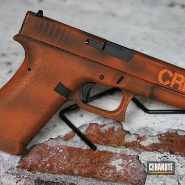 Battleworn Glock P80 Cerakoted Using Hunter Orange And Graphite Black