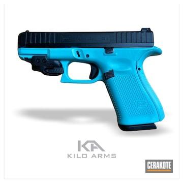 Two Tone Glock 44 Cerakoted Using Robin's Egg Blue