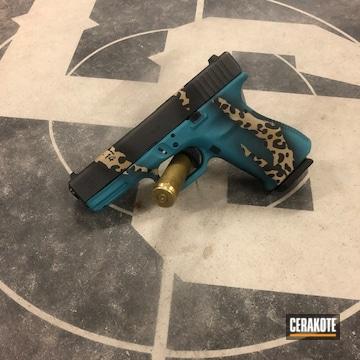 Custom Glock 19 Cerakoted Using Noveske Tiger Eye Brown, Aztec Teal And Graphite Black