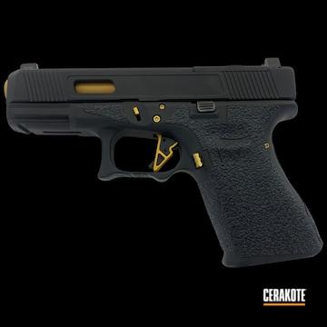 Glock 23 Cerakoted Using Armor Black And Gold
