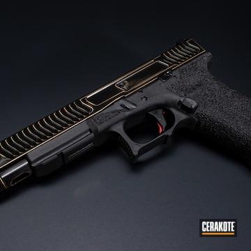 Distressed Glock 17l Cerakoted Using Graphite Black And Gold