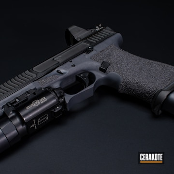 Battleworn Glock 17 Cerakoted Using Graphite Black And Stone Grey