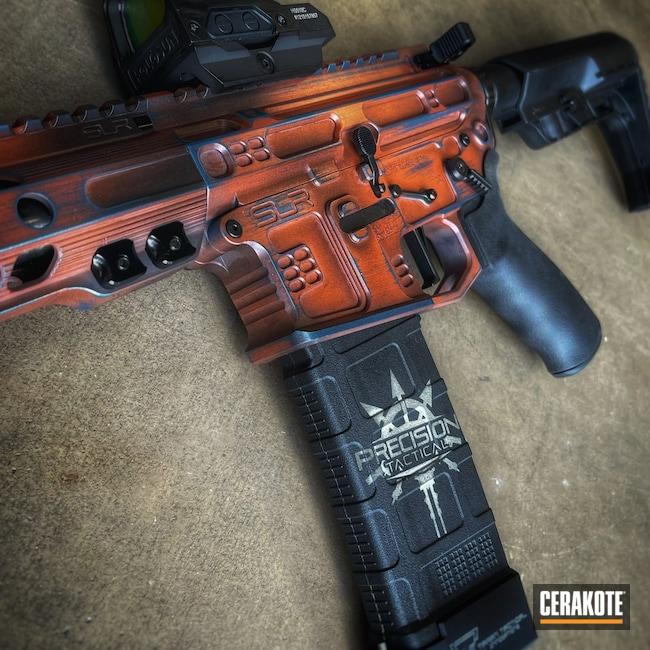 Cerakoted: S.H.O.T,SLR Rifleworks,Armor Black H-190,.223,TERRA COTTA H-325,Blue Titanium H-185
