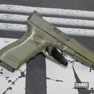 Battleworn Glock 22 Pistol Cerakoted Using Sniper Green And Gloss Black