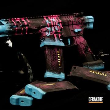 Airsoft Gun Cerakoted Using Blue Raspberry, Prison Pink And Graphite Black