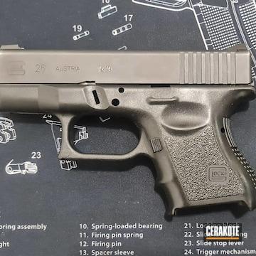Glock 26 Cerakoted Using Desert Sand And Graphite Black