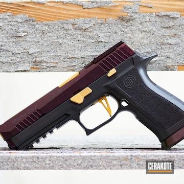 Pistols Cerakoted Using Combat Grey, Cobalt And Gold