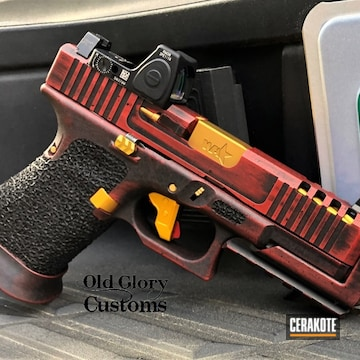 Battleworn Glock 19 Cerakoted Using Graphite Black, Firehouse Red And Gold