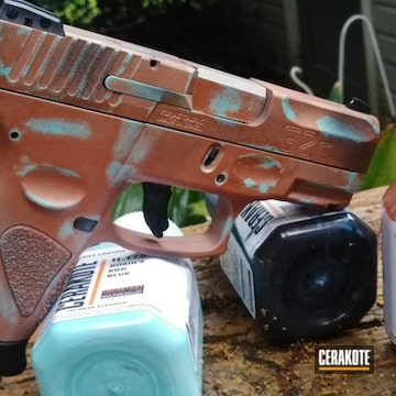Copper Patina Taurus Pistol Cerakoted Using Graphite Black, Robin's Egg Blue And Copper
