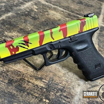 Jurassic Park Themed Glock Cerakoted Using Zombie Green, Graphite Black And Firehouse Red