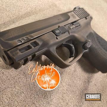 Distressed Smith & Wesson M&p Pistol Cerakoted Using Graphite Black And Burnt Bronze