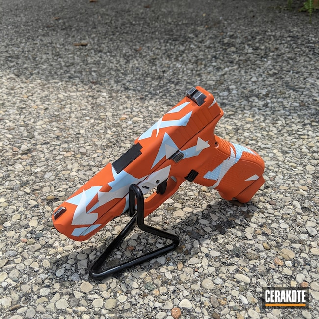 Cerakoted: Bright White H-140,S.H.O.T,Glock,Splinter Camo,Hunter Orange H-128,It's A Boy H-356