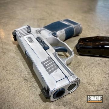 Battleworn Sig Sauer P365 Pistol Cerakoted Using Stormtrooper White, Crushed Silver And Blue Titanium