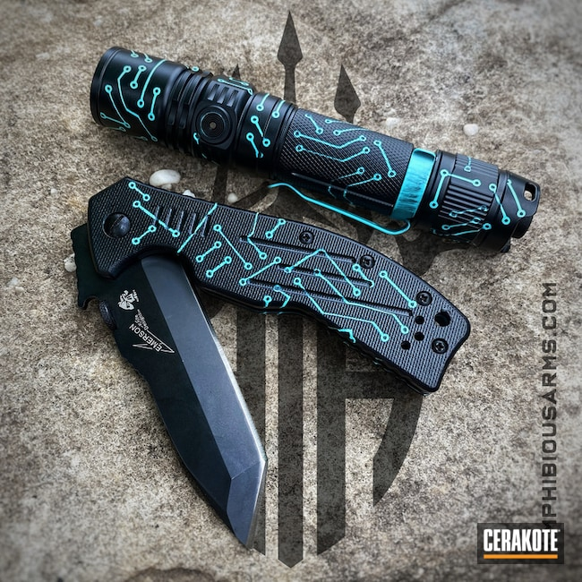 Emerson Knife And Fenix Flashlight Cerakoted Using Robin's Egg Blue And Midnight Blue