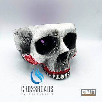 Skull Sculpture Cerakoted Using Frost, Usmc Red And Bright Purple