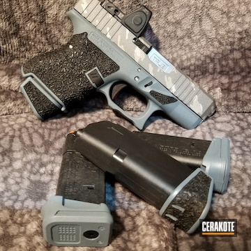Glock 26 Cerakoted Using Snow White, Crushed Silver And Jesse James Cold War Grey
