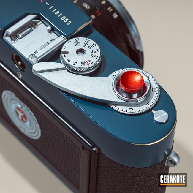 Cerakoted: Camera,Corvette Yellow H-144,Custom,Leica,Ridgeway Blue H-220,Armor Black H-190