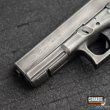 Distressed Glock 22 Cerakoted Using Crushed Silver And Graphite Black