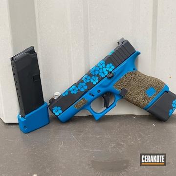 Flowered Themed Glock Cerakoted Using Ridgeway Blue, Graphite Black And Sea Blue