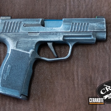 Distressed Sig Sauer P365 Pistol Cerakoted Using Stone Grey, Graphite Black And Blue Titanium