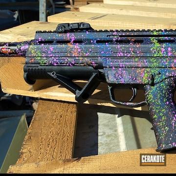 Paint Splatter Themed Bullpup Shotgun Cerakoted Using Hunter Orange, Periwinkle And Zombie Green
