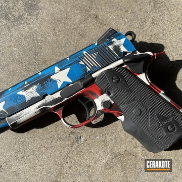 Distressed American Flag Themed Colt 1911 Pistol Cerakoted Using Snow White, Sky Blue And Graphite Black