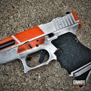 Distressed Glock Cerakoted Using Hunter Orange, Snow White And Graphite Black