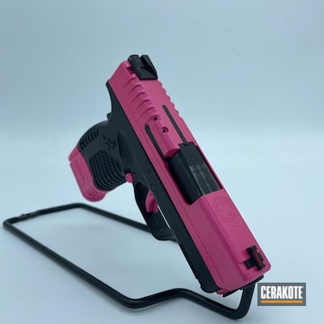 Pistol Cerakoted Using Prison Pink
