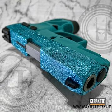 Glittered Taurus G2c Pistol Cerakoted Using Aztec Teal