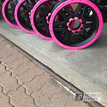Two Tone 4x4 Wheels In A Pink And Black Powder Coat
