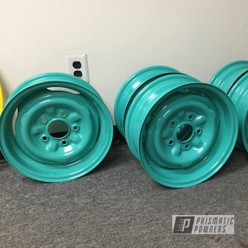 Powder Coated Teal 1957 Oem Chevy Wheels