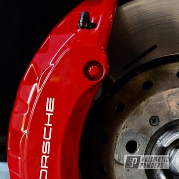 Red Porsche Brake Calipers