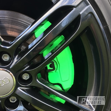 Black And Green Wheels And Brake Calipers