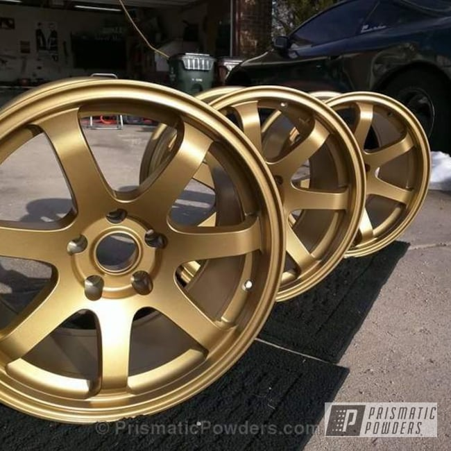 Set Of Wheels Coated In Our Poly Gold Powder Coat