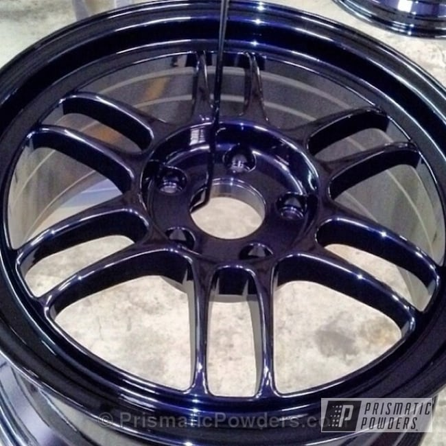 Custom Rim coated in our Purple Metallic Powder Coat