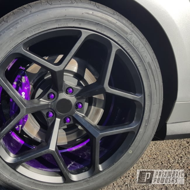 Refinished Wheels Brake Calipers And Engine Parts With A Purple Finish Prismatic Powders