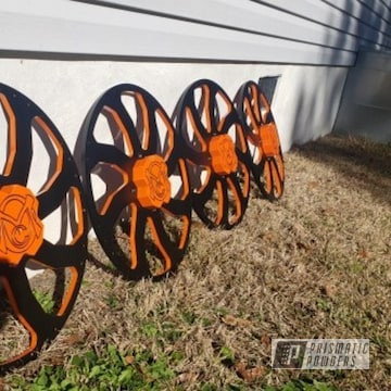 Powder Coated Orange And Black Two Toned Polaris Wheels