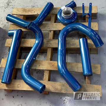 Powder Coated Nissan Turbo System In Hustler Blue And Clear Vision
