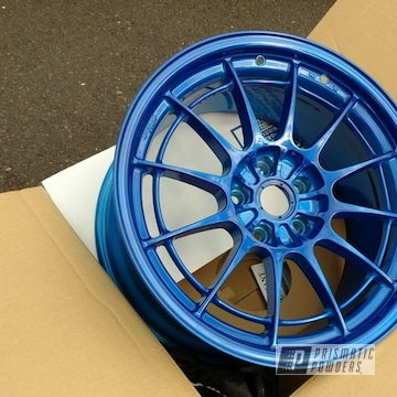 Peeka Blue And Heavy Silver On An Automotive Rim