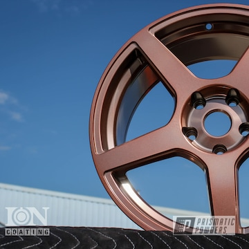 Automotive Wheel Coated In Penny Dust And Super Chrome