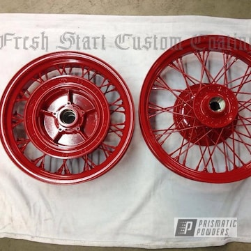 Motorcycle Wheels Coated In Astatic Red