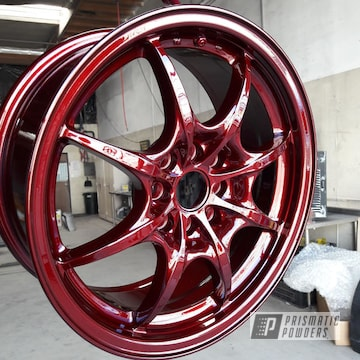 Custom Wheel coated  in Illusion Cherry and Clear Vision