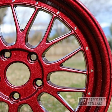 Custom Wheels Coated In Racing Red Over Kingsport Grey