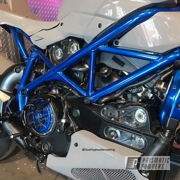 Motorcycle Frame Coated In Peeka Blue Over A Super Chrome Base Coat