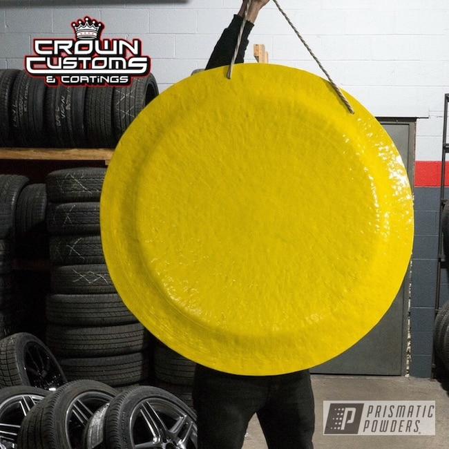 A Gong Coated In Sunshine Yellow
