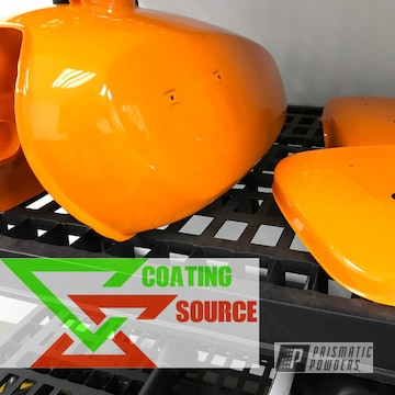 Gas tank and side covers powder coated in Juju Orange and Clear Vision
