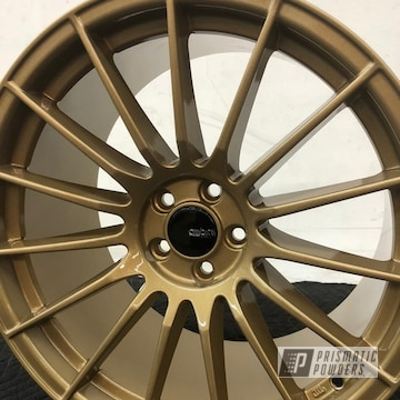 Subaru Wheels Done In Spanish Gold And Clear Vision Powder Coat